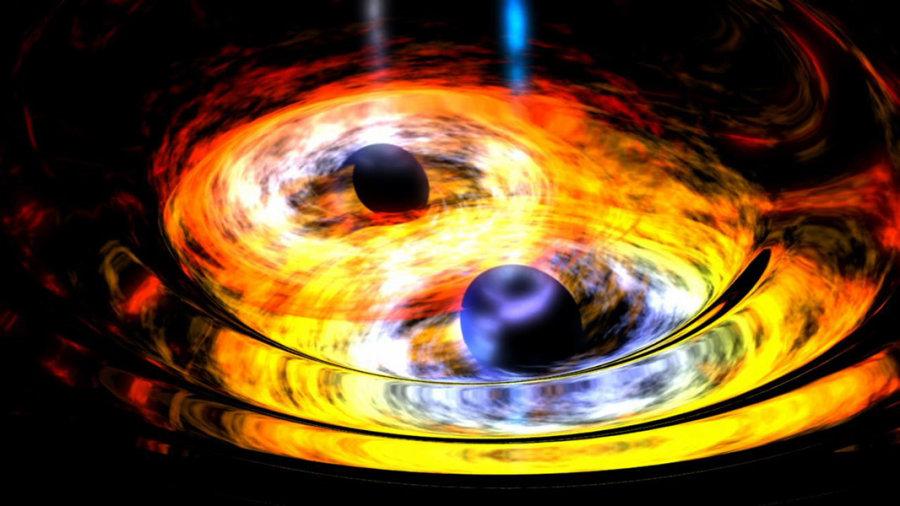 La coppia di buchi neri è ormai vicinissima e trascina con sé l'intreccio dei dischi di accrescimento che formano una zona calda, la cui luminosità ci invia un segnale periodico, simile a quello di una pulsar. Fonte: NASA