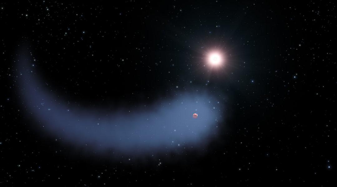 """Una visione artistica del Nettuno """"spogliato"""", con l'enorme coda di idrogeno, mentre rivolve attorno alla sua nana rossa GJ 436. Credit: NASA, ESA, e G. Bacon (STScI)"""