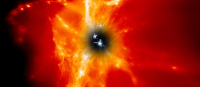 Una galassia simile alla nostra è mostrata al centro dell'immagine, circondata dal mezzo intergalattico. Esso appare nero ai nostri occhi, ma in realtà contiene gas caldissimo, che viene mostrato di color rosso, arancio e bianco.  L'immagine è, ovviamente, una rappresentazione artistica confermata dalle osservazioni di Hubble nell'ultravioletto. Fonte: Adrien Thob, LJMU