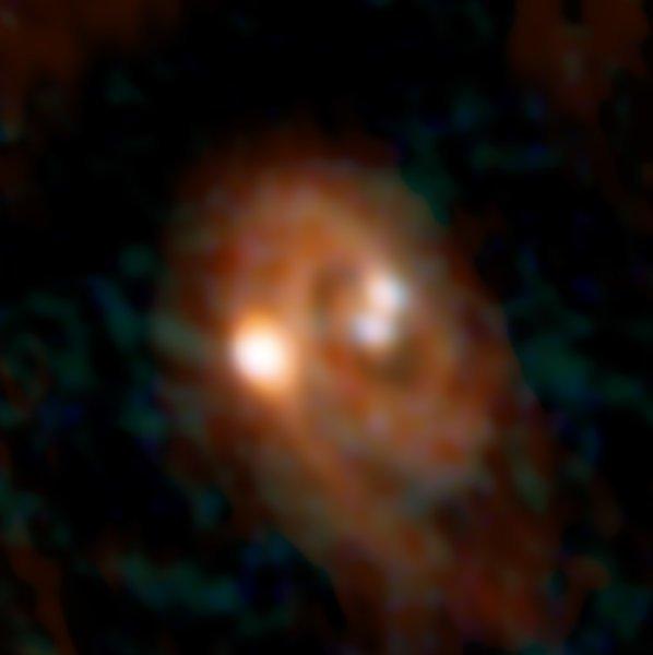 Immagine deel sistema triplo L1448 IRS3B, ottenuta combinando i dati di ALMA e VLA. Fonte: Bill Saxton, ALMA (ESO/NAOJ/NRAO), NRAO/AUI/NSF