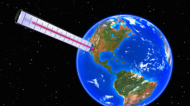 Thermometer Taking Earth's Temperature --- Image by © Kulka/Corbis