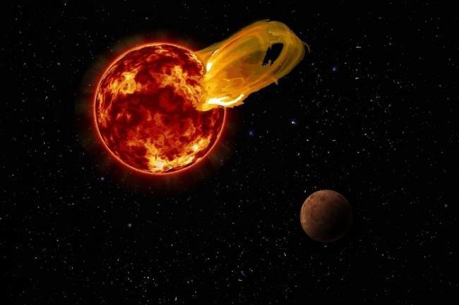 """Visione artistica del """"flare"""" di Proxima Centauri osservato da ALMA nel marzo del 2017. Il povero pianeta Proxima b orbita la sua stella su un orbita venti volte più vicina rispetto a quella della Terra attorno al Sole. Un """"flare"""" dieci volte più grande del più grande flare solare mai osservato ha investito il pianeta """"abitabile"""" con una radiazione 4000 volte superiore a quanto siamo abituati.. Fonte: Roberto Molar Candanosa / Carnegie Institution for Science, NASA/SDO, NASA/JPL."""