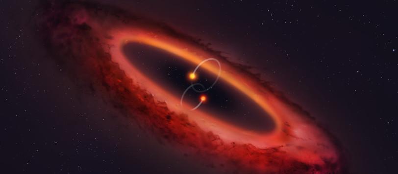 Figura 1. Un  modello he illustra in sistema stellare doppio con il disco protoplanetario ortogonale al piano orbitale delle due stelle. Fonte: