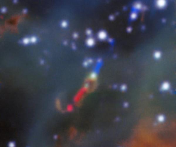 Si nota molto bene il doppio getto, rosso e blu, colori dovuti all'effetto doppler. Fonte: ESO, A McLeod et al.